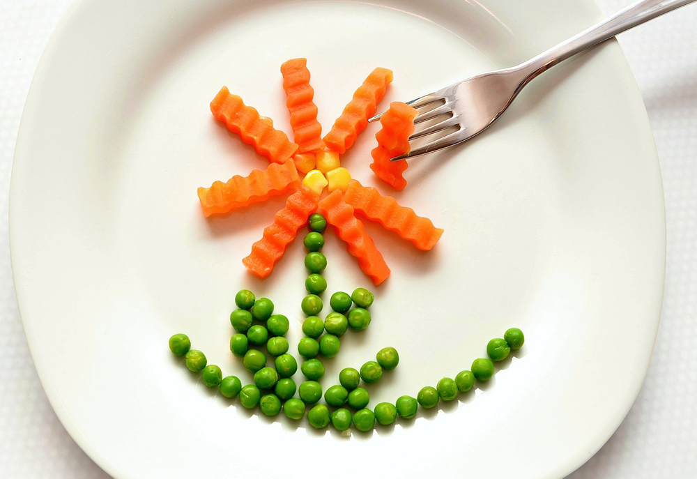 healthy carrots and peas on a plate